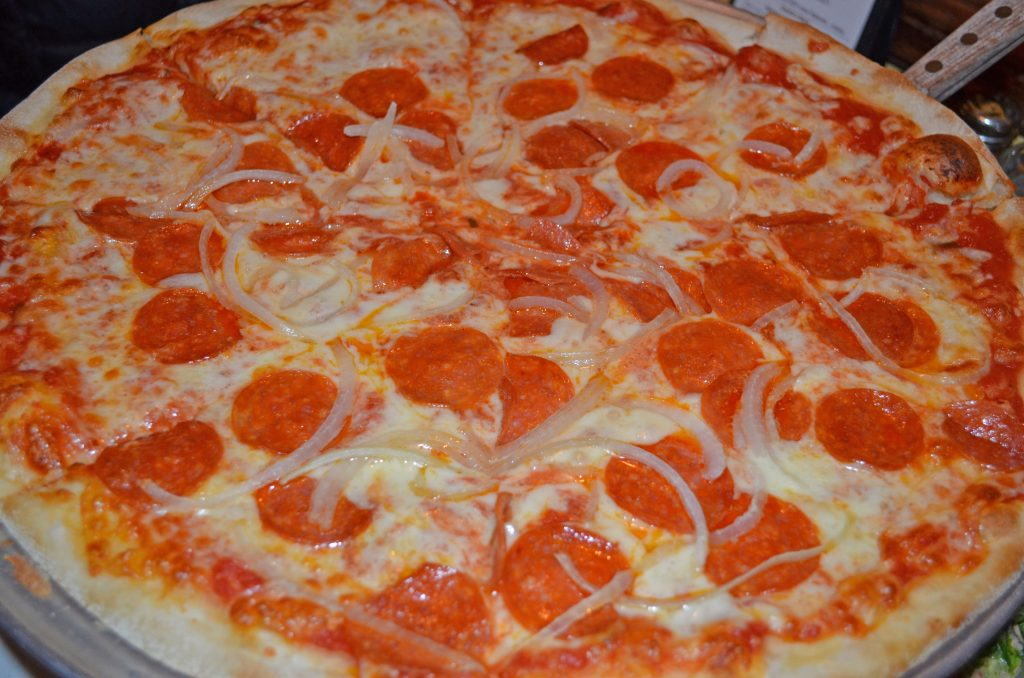 Pepperoni and onion pizza